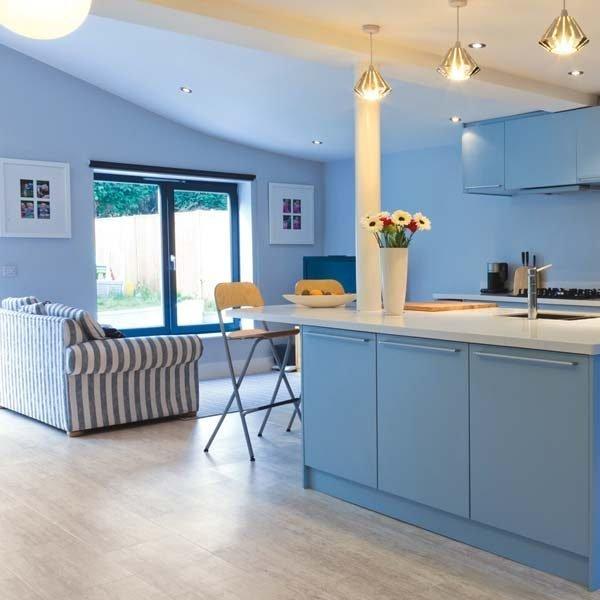 Sandstone look flooring in a blue kitchen