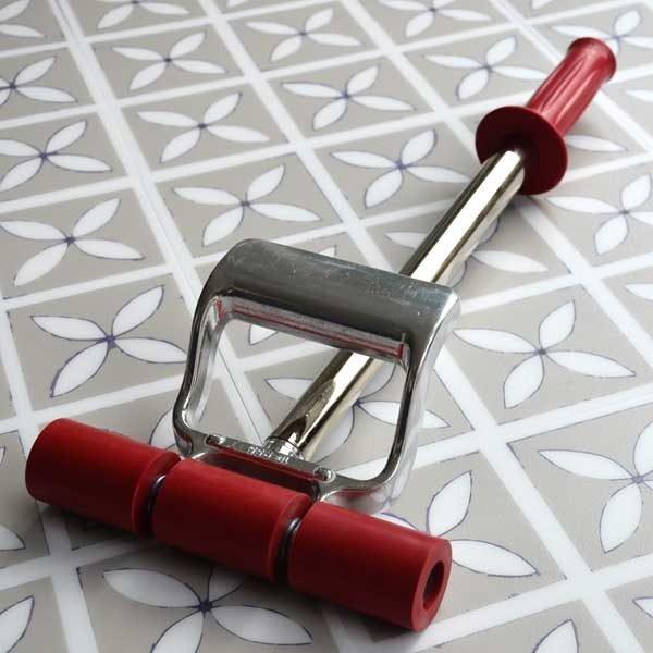 vinyl roller on patterned floor tiles