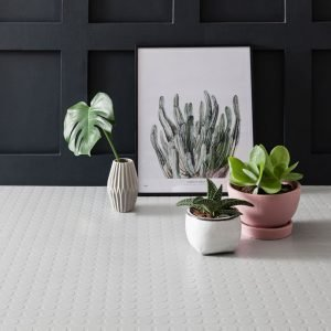 white rubber dimple floor tiles with plants
