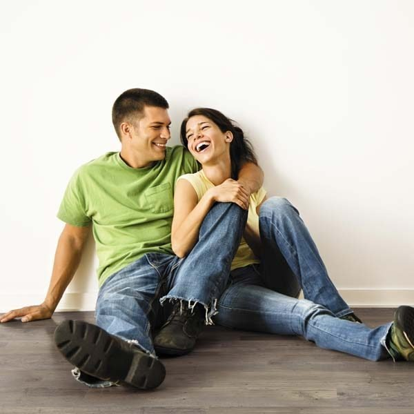 Couple siting on a hickory wood effect floor