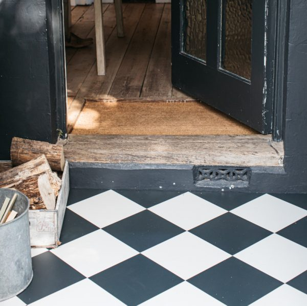 Black & White Checkerboard flooring in a porch