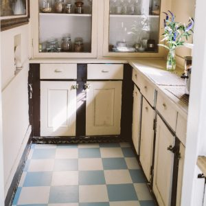 blue and white retro chequered flooring in vintage kitchen