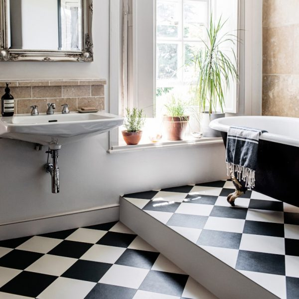 black and white checkerboard flooring in a bathroom