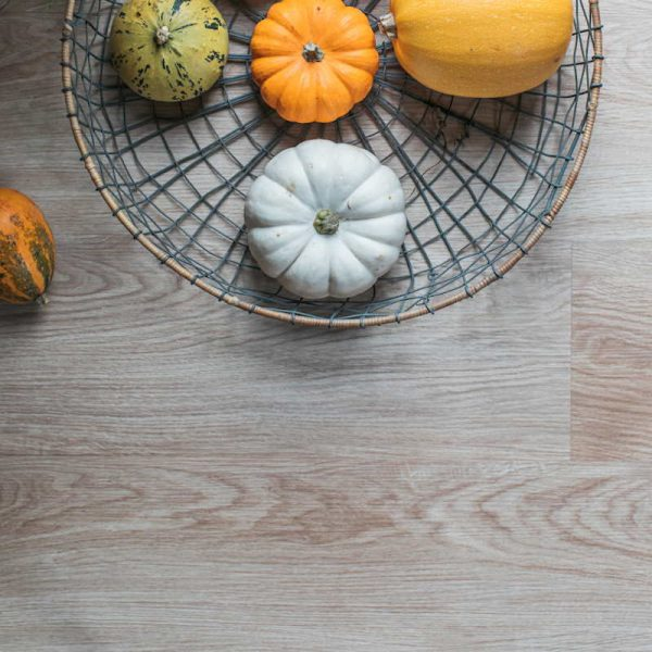 blonde oak wood floor close up with pumpkins