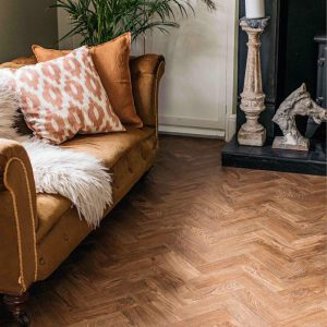 leather sofa with parquet wood flooring