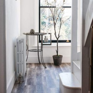 modern hallway with wood effect brown grey flooring