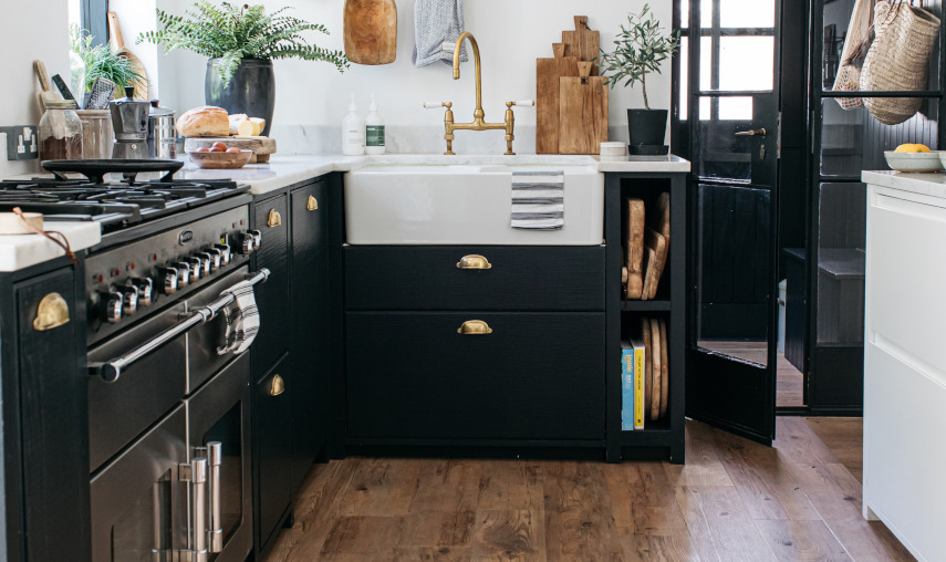 coppice kitchen flooring with dark units and butler sink