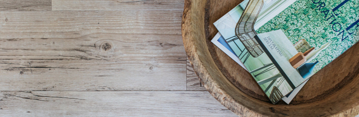 wooden floor with bowl of magazines