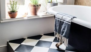checkerboard flooring in a traditional bathroom