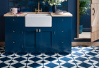 Blue kitchen with geometric blue and white floor tiles