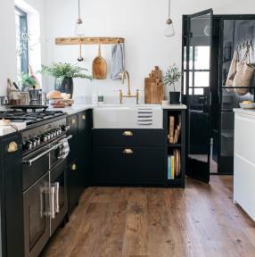 dark contemporary kitchen units with wood plank flooring