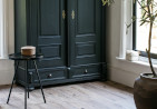light wash wood planks against dark wardrobe and table