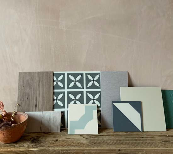 A variety of flooring samples lined up against a pale backdrop