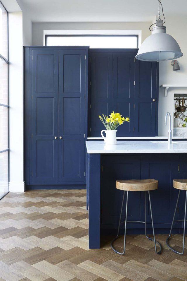 blue kitchen with parquet wood floor