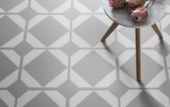 neutral geometric floor tiles with marble table