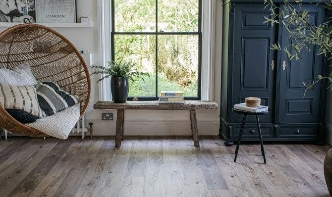 wood effect floor in modern rustic room with hanging chair