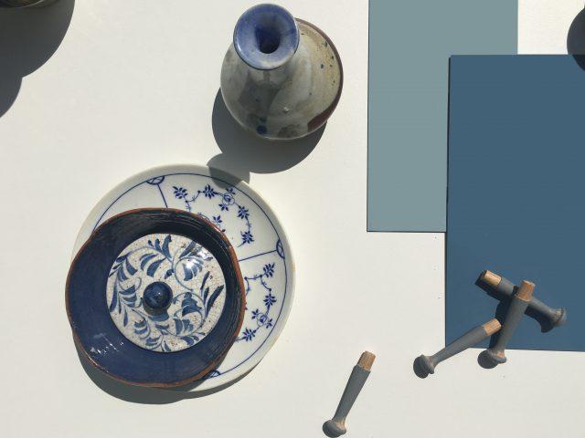 blue vinyl floor with pottery