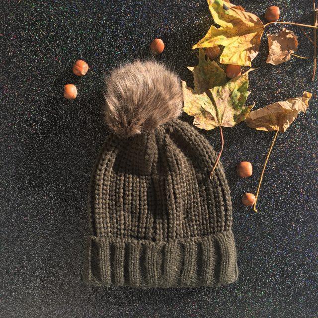 winter hat on black sparkely floor
