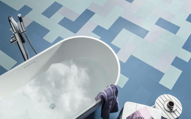 multitonal blue vinyl tiles in bathroom
