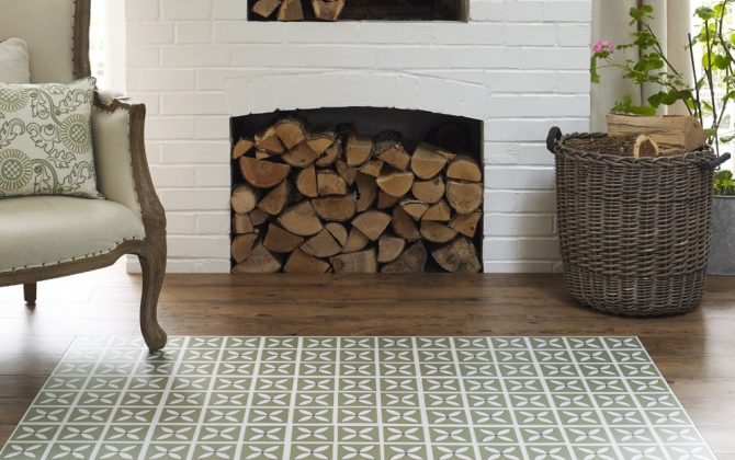 green patterned floor tiles in traditional room with fireplace
