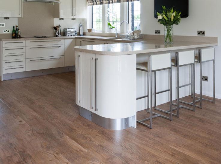 neutral kitchen with wooden flooring