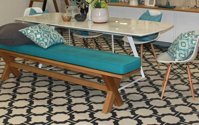 parquet monochrome floor with blue kitchen bench