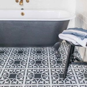 black and white bathroom with patterned flooring