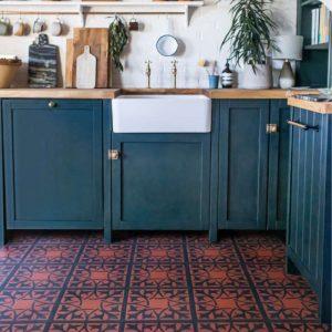northmore fired terracotta floor tiles in green kitchen