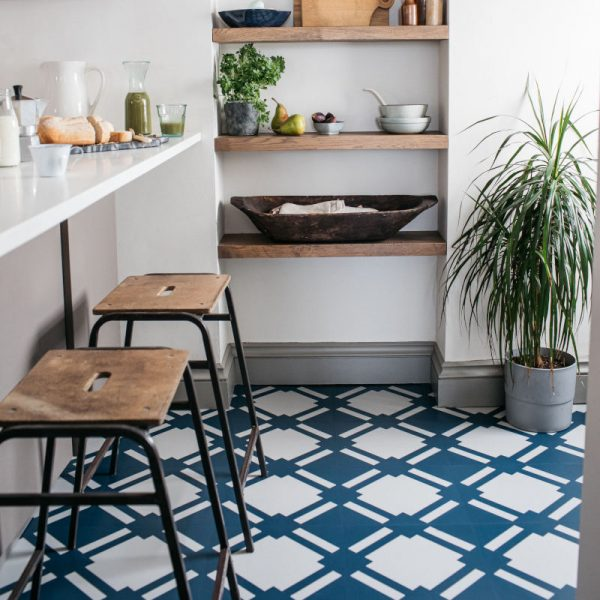Navy blue patterned tiled floor in contemporary kitchen