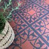 terracotta vinyl flooring tiles with encaustic tile pattern