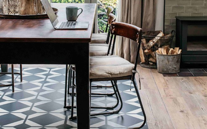 home office in dining room with pattern and wood border