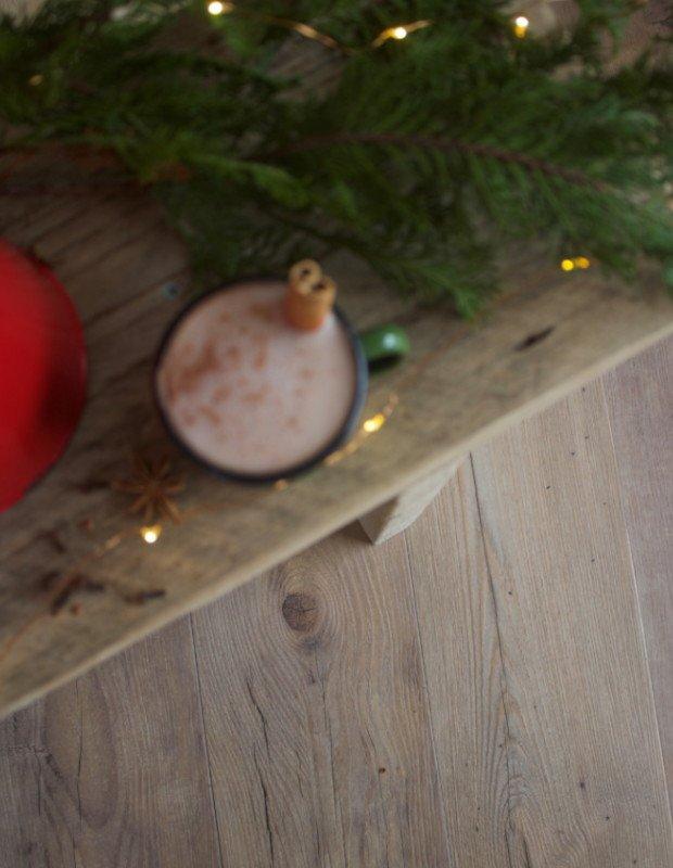 christmas cinnamon hot chocolate on wooden bench