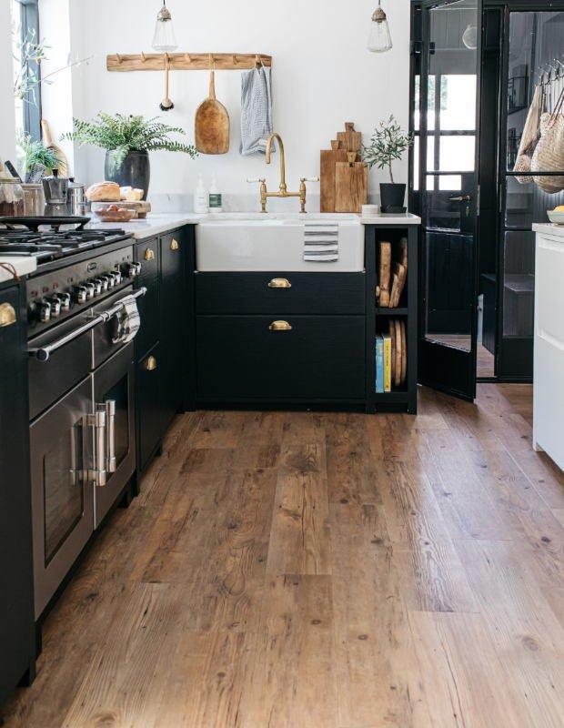 wood modern kitchen floor in navy kitchen