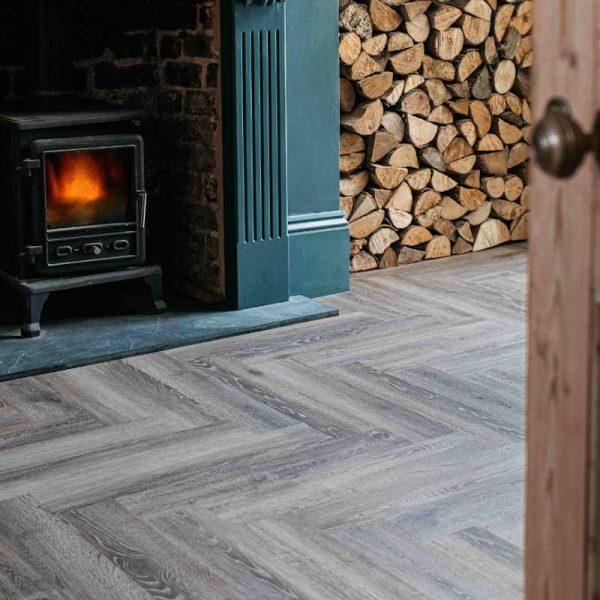 wood effect floor herringbone pattern in living room fireplace