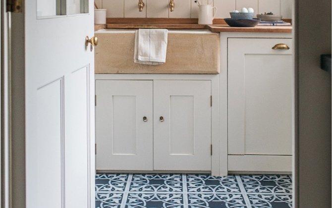 blue decorative floor tiles in cottagecore kitchen pantry