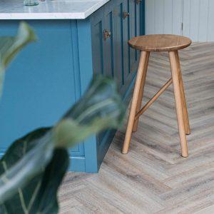 doormouse wood herringbone flooring in blue kitchen