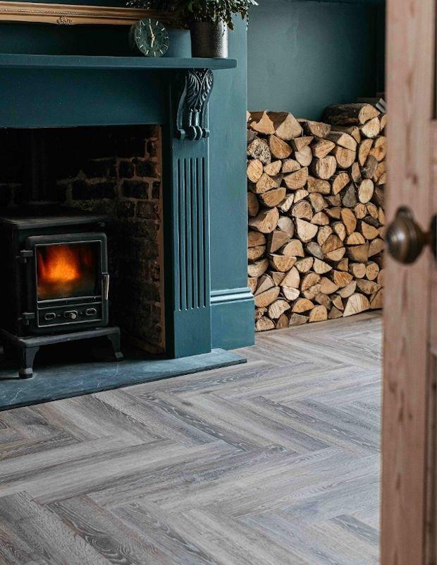 torn bracken wooden flooring in traditional fireplace