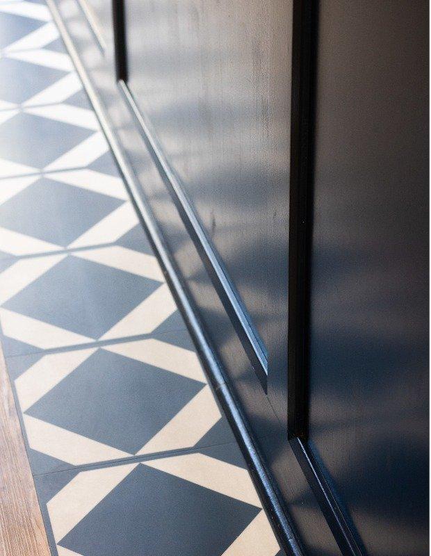 geometric lvt tiles bordering restaurant bar
