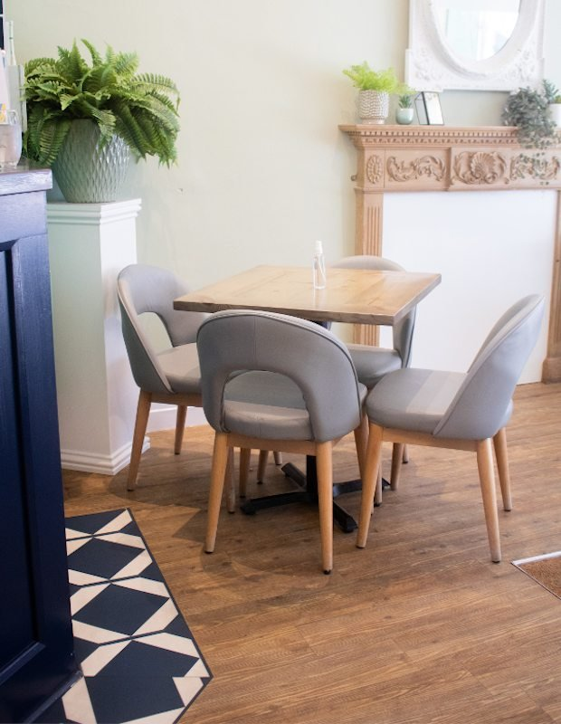 oxford blue floor tiles next to table and chairs