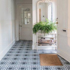 Black patterned floor in a hallway