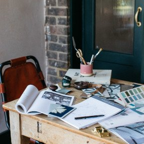 desk covered with stationery
