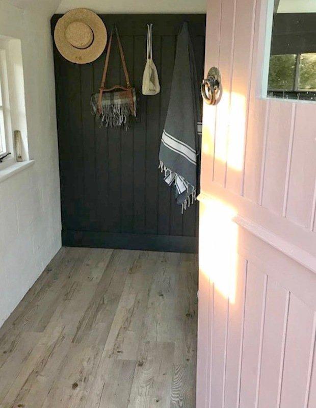 guest bedroom with wooden vinyl flooring