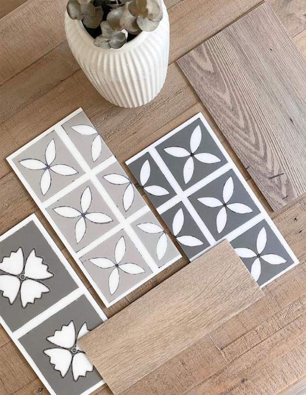 decorative floral tiles on a wooden table