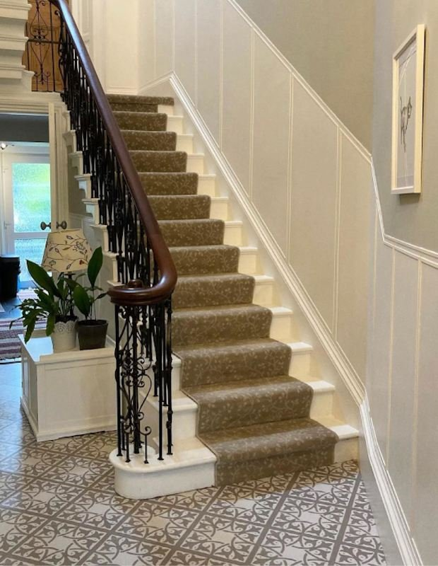staircase surrounded by neutral encaustic floor tiles