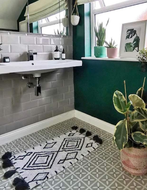 eclectic light floral floor tiles in green bathroom
