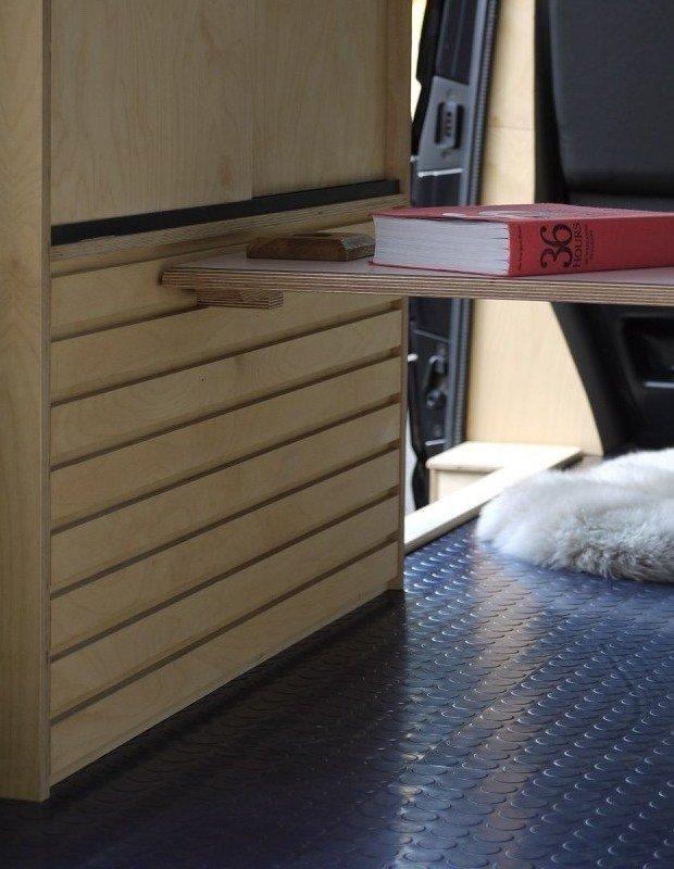 dark rubber flooring in a converted van