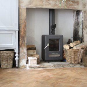 Spring Oak LVT by a fireplace