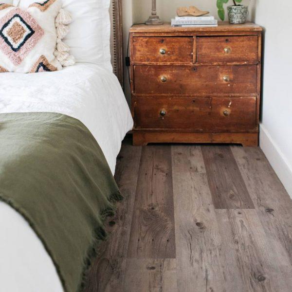 wood vinyl plank floor in traditional bedroom