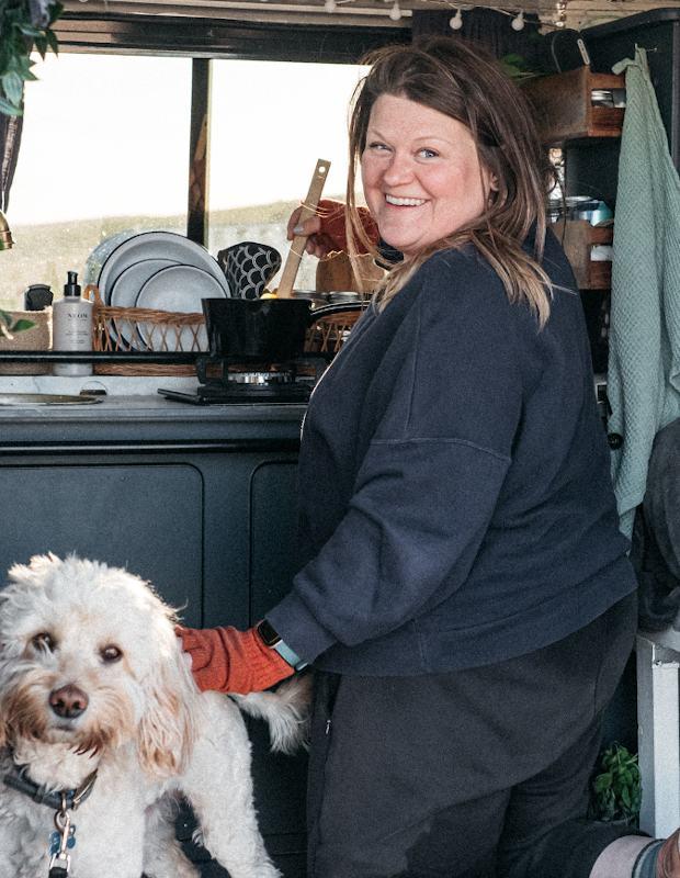 woman cooking in converted van