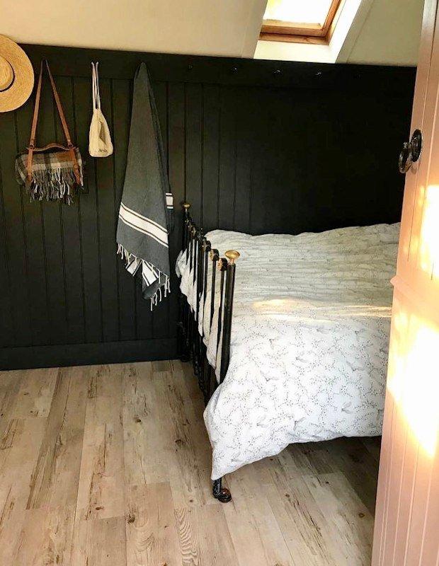 scandi guest bedroom with wood vinyl floor